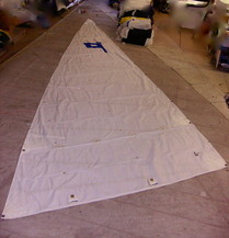 Small sail spread out on the floor of the loft.