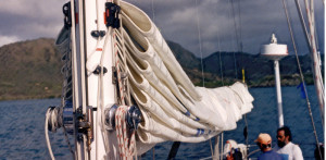 Neatly flaked main sail on boat