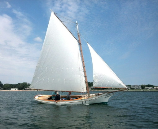 Gaff rigged sloop with white Linthicum sails